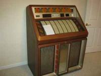 for sale is a nice condition jukebox which plays single