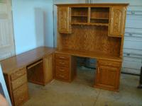 For sale  Amish solid oak three piece corner desk  This