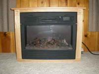 This is a very nice electric fireplace with flames. It