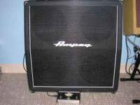 For sale is this Ampeg 4x12 slant cabinet, handles 200