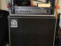 The bass cabinet is the Ampeg SVT410HLF. The amp is the