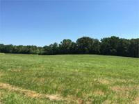 7.36 acres of fescue pasture and hayfield. Perfect for