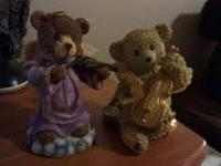 I have two little bear figurines that are dressed as