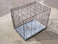 1 large used cage with bottom tray. We on longer need.