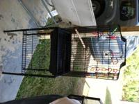 Wooden Animal Cage. Used for shade by our cat and as an