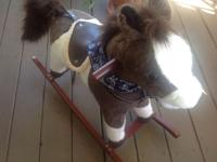 Cute Animated Rocking Horse Has bandana and saddle