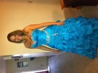 beautiful blue anny lee prom or pageant dress. It has a