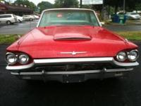 Red 1965 Ford Thunderbird.Paint is decent not new like