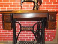 1903 singer sewing machine built in a cabinet. normal