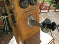 This vintage 5 bar magneto crank wall telephone is made