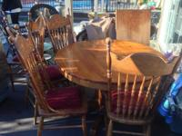 I have a very nice vintage oak table set that features