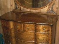 This is a classic design 4 drawer dresser with a oval,