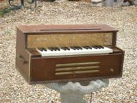 This is a really neat antique organ. It has an electric