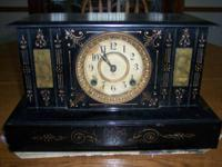 Decorative antique metal mantle clock.  made by the