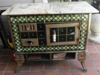 BEAUTIFUL ANTIQUE IRON STOVE WITH TILED FINISH. THERE