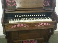 We have for sale this gorgeous antique pump organ by