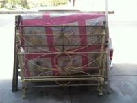 This is an Antique Cast Iron and Brass bed frame. The