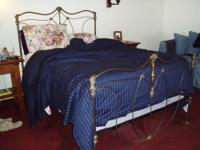 This is a full sized iron bedframe with brass accents.