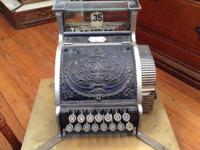 Very rare extended base brass National cash register.