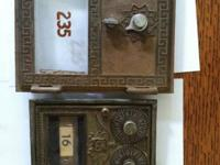 I'm selling antique bronze PO box doors. The smaller
