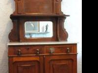 This is a beautiful Victorian walnut sideboard from the