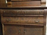 Cabinet is wood with wood veneer. It is really old,