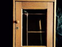 "Antique oak cabinet with glass front doors. 28"" x 16 x"