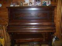 A turn of the century Capen upright Grand made in