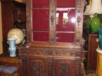 This is a very unique high quality carved Hunt Cabinet