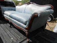 Provided is an antique sofa. Feet and crest sculpted,