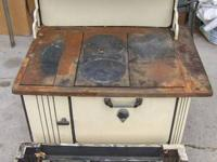 For sale is this 1895 cast iron and porcelain stove and