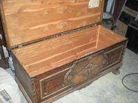 A antique cedar chest that measures 48 inches long,19