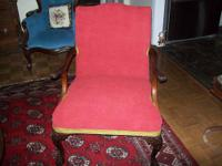 Antique Chair has new red covering and gold trim also