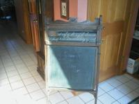 This antique chalk board/desk combination dates from