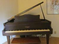 Beautiful mahogany baby grand piano, bench included