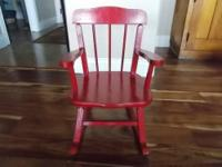 This is a very cute vintage OAK rocking chair that has