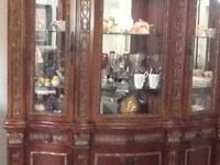 This is an old antique china cabinet. It's lighted and