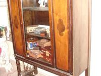 This china cabinet is gorgeous and features two clovers