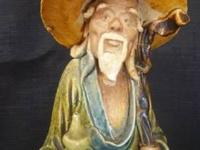 For sale is an antique Chinese mudman figure - he is an
