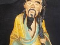 For sale is an antique Chinese mudman figure - a seated