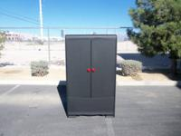 Antique closet repainted black with red hardware. The