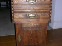 This is a handcrafted antique commode cabinet. It was