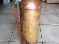 This is a terrific Antique Copper Fire Extinguisher.