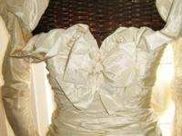 Antique cream color satin bridal gown. I even have the
