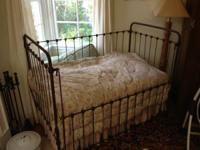 Beautiful old wrought iron antique crib with mattress