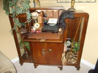 Very old desk with two glass curio cabinets on either