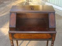 This is a very old desk that the top opens to reveal a