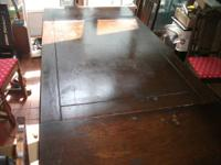WE HAVE A VERY NICE ANTIQUE LEAF TABLE WITH 4 CHAIRS