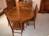 Large strong wood dining table with six wood chairs