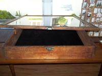 "Wooden, w/ glass top, measures, 32""L X 30""W X 6""H, Lost"